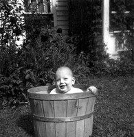 1951_baby_bruce_in_wooden_bucket_outside_Scanned Image-0_p