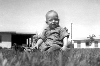 1951_toddler_bruce_sitting_in_grass_Scanned Image-1a_p