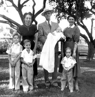 1953_brian_under_trees_with_randy_doug_opal_hilton_peggy_and_baby_sue_Scanned Image