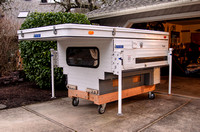 Front corner view of Four Wheel camper on dolly