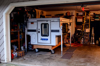 Four Wheel camper on dolly in garage